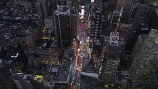 AX89_084 - 4K stock footage aerial video Approaching Times Square, Midtown Manhattan, tilt down, New York, twilight