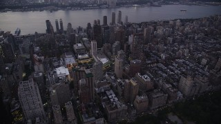 AX89_087 - 4K stock footage aerial video Flying by skyscrapers, Upper West Side, New York, New York, twilight