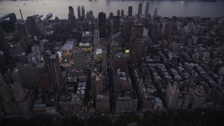 AX89_088 - 4K stock footage aerial video Flying by skyscrapers, Upper West Side, New York, New York, twilight