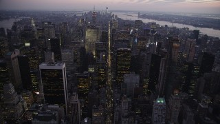 AX89_093 - 4K stock footage aerial video Approaching Midtown Manhattan, New York, New York, twilight