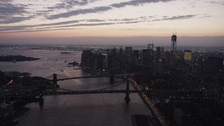 AX89_105 - 4K stock footage aerial video of the Brooklyn Bridge, Manhattan Bridge, East River, Lower Manhattan, New York, twilight