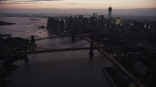 AX89_106 - 4K stock footage aerial video of the Brooklyn Bridge, Manhattan Bridge, East River, Lower Manhattan, New York, twilight