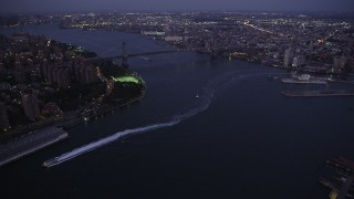 AX89_108 - 4K stock footage aerial video Approaching Williamsburg Bridge, New York, New York, twilight