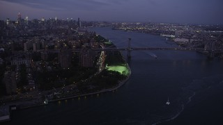 AX89_109 - 4K stock footage aerial video Approaching the Williamsburg Bridge, Lower East Side, New York, twilight