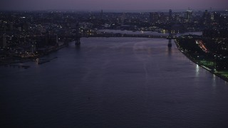 AX89_115 - 4K stock footage aerial video Approaching Williamsburg Bridge, East River, New York, New York, twilight