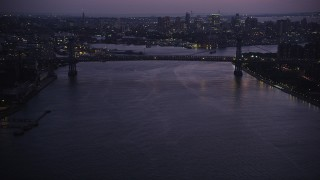 AX89_116 - 4K stock footage aerial video Approaching the Williamsburg Bridge, East River, New York, New York, twilight