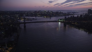 AX89_117 - 4K stock footage aerial video Approaching Williamsburg Bridge, East River, New York, New York, twilight