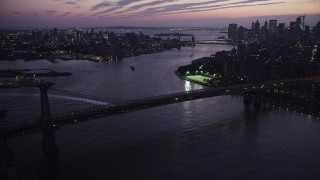 AX89_118 - 4K stock footage aerial video Flying by Williamsburg Bridge, tilt down, New York, New York, twilight