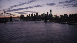 AX89_121 - 4K stock footage aerial video Approaching Lower Manhattan, Manhattan Bridge, New York, New York, twilight