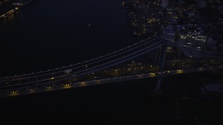 AX89_125 - 4K stock footage aerial video Flying by Manhattan Bridge, Brooklyn, New York, New York, sunset