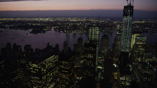 AX89_133 - 4K stock footage aerial video Paning to One World Trade Center, Lower Manhattan, New York, twilight