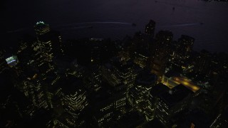 AX89_134 - 4K stock footage aerial video Approaching Lower Manhattan skyscrapers, New York, New York, twilight