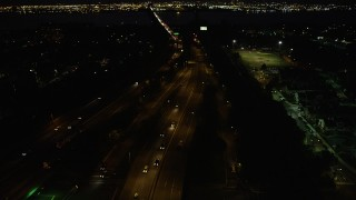 AX89_152 - Aerial stock footage of New Jersey Turnpike Extension, Newark Bay Bridge, Newark, New Jersey, night