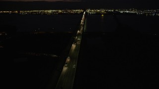 AX89_153 - 4K stock footage aerial video Flying by Newark Bay Bridge, Newark, New Jersey, night