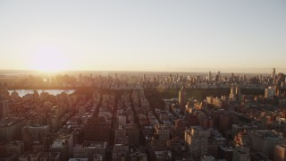 AX90_034 - 4K stock footage aerial video Flying by Upper West Side, New York, New York, sunrise