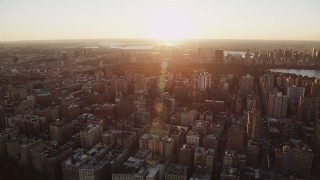AX90_035 - 4K stock footage aerial video Flying by Upper West Side, New York, New York, sunrise