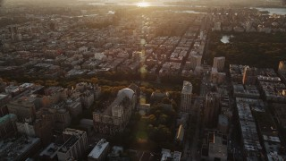 AX90_037 - 4K stock footage aerial video of the Cathedral of Saint John the Divine, Morningside Heights, New York, sunrise