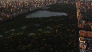 AX90_038 - 4K stock footage aerial video Flying over Central Park, approaching Midtown, New York, New York, sunrise