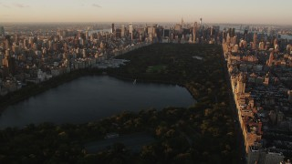 AX90_039 - 4K stock footage aerial video Flying over Central Park, approaching Midtown, New York, New York, sunrise