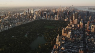 AX90_042 - 4K stock footage aerial video Flying by Central Park, approaching Midtown Manhattan, New York, sunrise