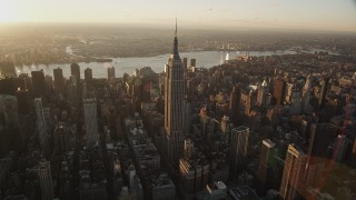 AX90_049 - 4K stock footage aerial video Flying by Empire State Building, Midtown Manhattan, New York, sunrise