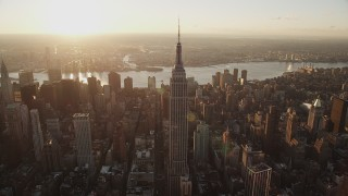 AX90_050 - 4K stock footage aerial video Flying by Empire State Building, Midtown Manhattan, New York, sunrise