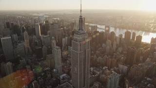AX90_051 - 4K stock footage aerial video Flying by the Empire State Building, Midtown Manhattan, New York, sunrise