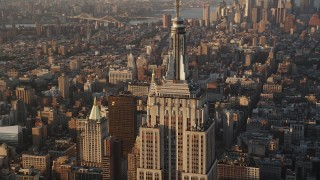 AX90_060 - 4K stock footage aerial video Flying by Empire State Building, Midtown Manhattan, New York, sunrise