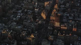 AX90_063 - 4K stock footage aerial video Flying over Greenwich Village, revealing Lower Manhattan, New York, sunrise