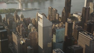 AX90_083 - 4K stock footage aerial video Flying by Citigroup Center in Midtown Manhattan, New York, New York, sunrise