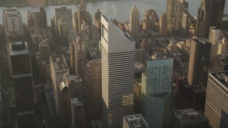 AX90_084 - 4K stock footage aerial video Flying by Citigroup Center, Midtown Manhattan, New York, New York, sunrise