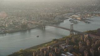 AX90_091 - 4K stock footage aerial video Approaching Williamsburg Bridge, East River, New York, New York, sunrise