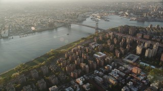 AX90_092 - 4K stock footage aerial video Approaching Williamsburg Bridge, Lower East Side, New York, sunrise