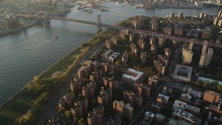 AX90_093 - 4K stock footage aerial video of Public housing, Lower East Side, Williamsburg Bridge, New York, sunrise