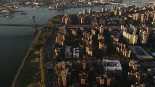 AX90_094 - 4K stock footage aerial video of Public housing, Lower East Side, Williamsburg Bridge, New York, sunrise