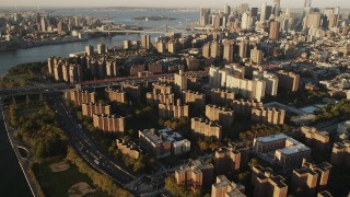 AX90_095 - 4K stock footage aerial video of Public housing, Lower East Side, Williamsburg Bridge, New York, sunrise