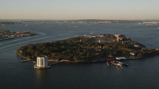 AX90_106 - 4K stock footage aerial video Approaching Governors Island, New York, New York, sunrise
