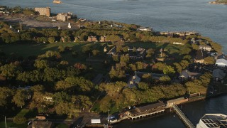 AX90_108 - 4K stock footage aerial video Flying by Fort Jay, Governors Island, New York Harbor, New York, sunrise