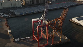 AX90_110 - 4K stock footage aerial video Flying by cargo cranes, Brooklyn Cruise Terminal, Brooklyn, New York, sunrise