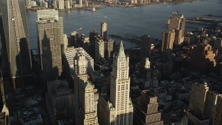 AX90_118 - 4K stock footage aerial video Flying by Woolworth Building, Lower Manhattan, New York, New York, sunrise