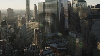 AX90_123 - 4K stock footage aerial video Flying by the World Trade Center, Lower Manhattan, New York, New York, sunrise