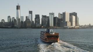 AX90_132 - 4K stock footage aerial video Flying by Staten Island Ferry, Lower Manhattan, New York, New York, sunrise