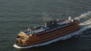AX90_135 - 4K stock footage aerial video Tracking the Staten Island Ferry sailing New York Harbor, New York, sunrise
