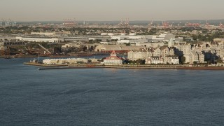 AX90_144 - 4K stock footage aerial video Approaching condominiums, Port Liberte, Jersey City, New Jersey, sunrise