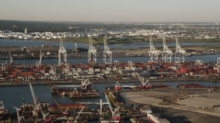 AX90_155 - 4K stock footage aerial video Approaching cargo cranes, containers, Port Jersey, New Jersey, sunrise