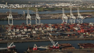 AX90_156 - 4K stock footage aerial video Approaching cargo cranes, containers, Port Jersey, New Jersey, sunrise