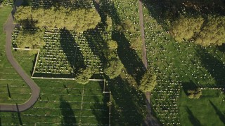 AX90_165 - 4K stock footage aerial video of Bayview New York Bay Cemetery, Jersey City, New Jersey, sunrise