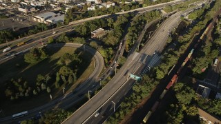 AX90_167 - 4K stock footage aerial video Approaching New Jersey Turnpike Extension, Jersey City, New Jersey, sunrise