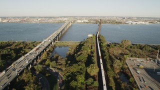 AX90_168 - 4K stock footage aerial video of Lehigh Valley Railroad Bridge, Newark Bay Bridge, Newark, New Jersey, sunrise
