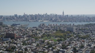 AX91_001 - 4K stock footage aerial video of the Midtown Manhattan skyline and Hudson River, New York, seen from Union City, New Jersey
